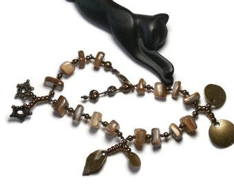 Bohemian bracelet with charms, mother of Pearl beige and bronze beads
