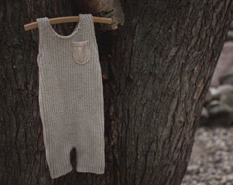 6-12 month tan REVERSIBLE sleeveless romper - front pocket detail - back with criss cross yarn tie closure