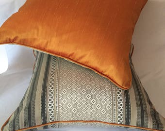 A pair of boho style scatter cushions