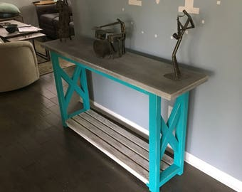 An Entryway or Sofa Table with Concrete Top.