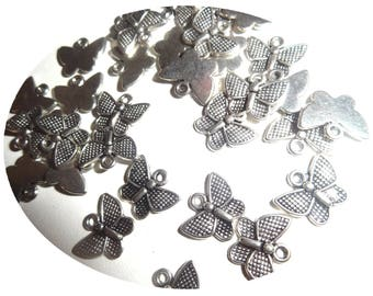 Set of 10 silver colored metal charms
