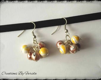 effects dangle earrings with Brown and yellow wave beads