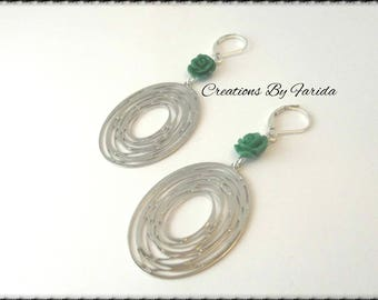 Oval print Silver earrings and a small green rose