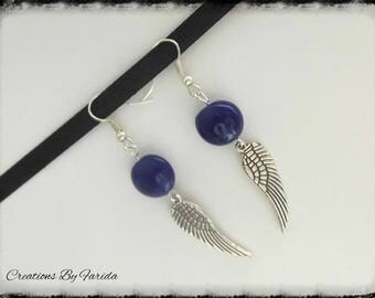 Dangle earrings with blue wings and night oval bead