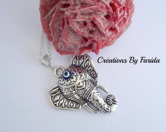 Necklace in silver with a cute elephant and blue eye brings good luck
