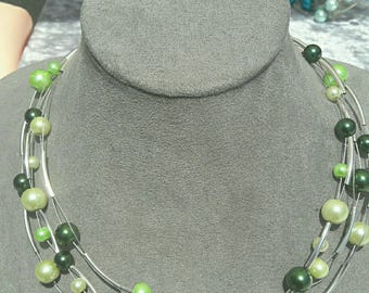 Multi-row necklace with green beads