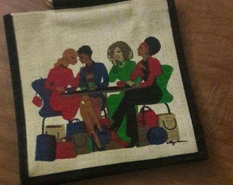 Unique hand bag with a depiction of ladies gathering