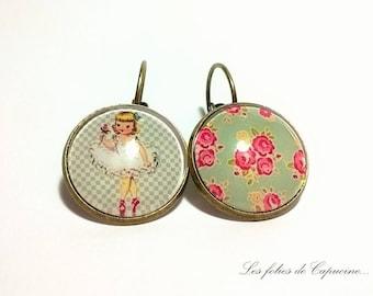 Earrings cabochon pink little girl model • • on green background