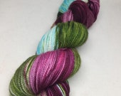 Hand dyed sock yarn in brilliant colors with hints of green and aqua, indie dyed superwash sock yarn