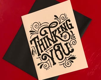 black and white hand lettered thinking of you card
