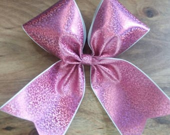 glitter metallic pink cheer bow made with vinyl on 3 inch wide grosgrain ribbon and ponytail holder