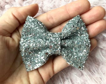 Silver Glitter Brooke Bow, on headband of clip