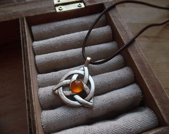 Celtic, Triquetra pendant adorned with a red agate