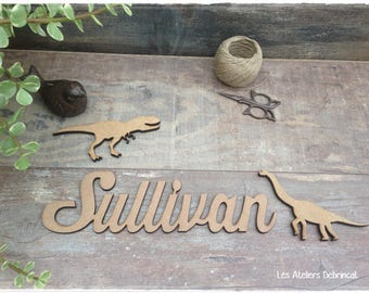 Name with dinosaur decoration made of wood