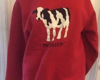 Red Hoosiers sweatshirt with a cow/Moosiers design