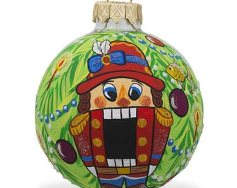 "3.25"" Nutcracker on Christmas Tree Glass Ball Christmas Ornament"