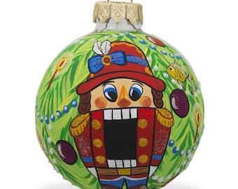 "3.25"" Nutcracker on Christmas Tree Glass Ball Christmas Ornament"