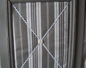 Old frame, weathered gray ticking fabric