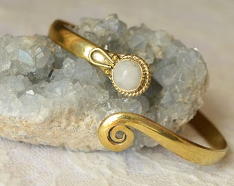 Adjustable solid brass bracelet with spiral and white moonstone. Hippy, gipsy, tribal.