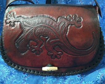 Handmade, hand tooled, leather purse with a gecko carved into front!