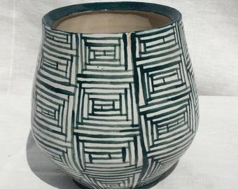 Hand painted vase in green and white
