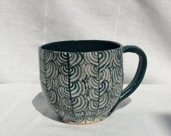 Green and white coffee mug