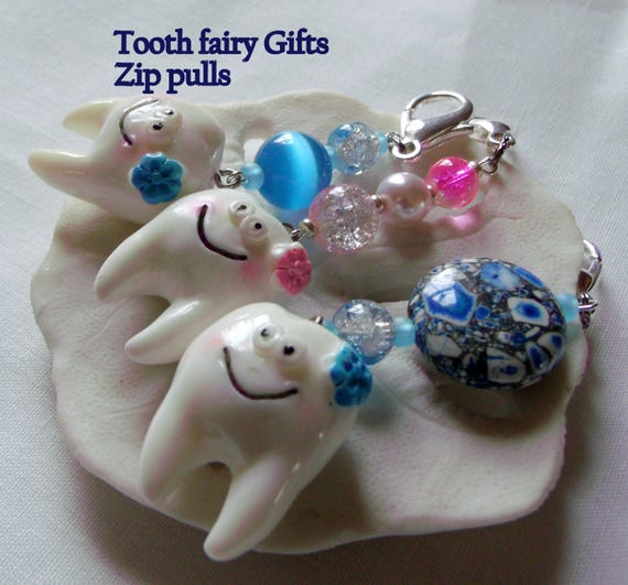 Tooth fairy zipper pull - boy and girl - large molar tooth - dental gift - whimsical smiling teeth - pink and blue white beads - Back pack