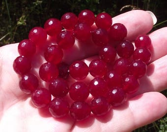 2 GARNET ROUND BEAD HAS FACETED 10 MM.