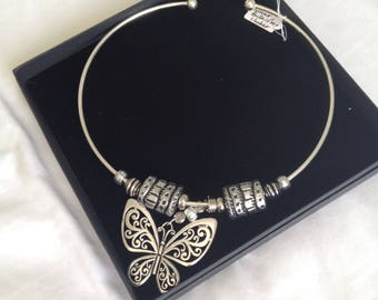 Silver-plated choker necklace. Large metal filigree butterfly and chunky metal beads.