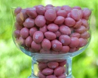 A half pound of pink strawberry Skittles