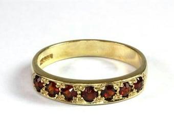 9ct Gold Half Eternity Garnet Set Ring. Size P.