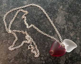 Two Glass Hearts Together on a Silver Necklace