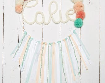 Dream catcher with tassels and word in knitting
