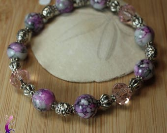 Pink marbled Glass Beads Bracelet with faceted glass beads