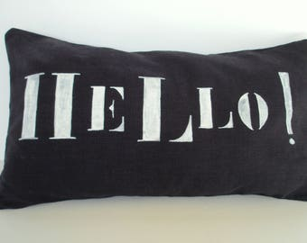 "Purple blue washed linen pillow cover dark inscription ""HELLO!"" in white"