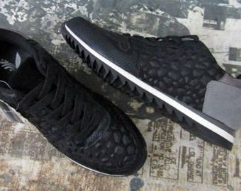 Black studded sneakers with decorative parts