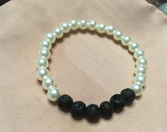 Pearl with black lava beads