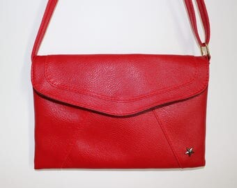 Red faux leather clutch bag