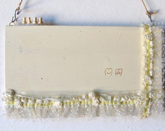 cream-coloured Panel photo frame with trina and little pearls