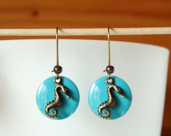 bronze earring with blue enameled sequin and seahorse