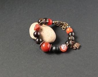 Red black gemstone bracelet Red carnelian bracelet Orange stone jewelry Love protection bracelet Garnet bracelet Elephant charm bracelet