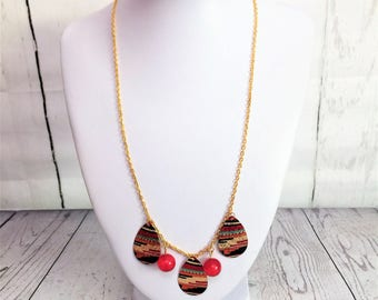 Lovely gold chain necklace with mulitcoloured teardrop beads and red glass beads