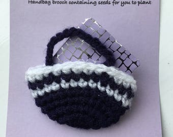 Handbag brooch containing seeds for you to plant