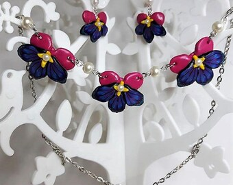 Purple and pink orchids set made of polymer clay.
