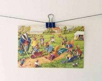 Vintage Racey Helps squirrel & rabbit postcard - Medici Society art illustration, cute animal picture, anthropromorphic badger, village fair