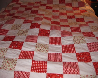 Red and White Checkerboard Quilt