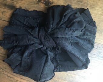 Black ruffle wrap