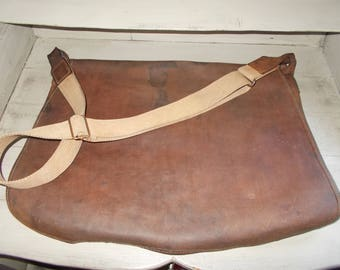 Vintage French Huge Leather Hunters Bag soft leather with interior netting bag in great condition, strong straps clean item, ready to wear.