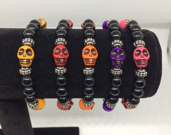 Skull bead stretchy bracelets, Halloween jewelry, 7 inch bead bracelets, orange,yellow,red,purple, pink skull w/black beads, silver accents