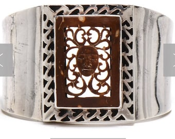 Sterling silver bracelet with Intricately carved With math Mask in theopen work Style.